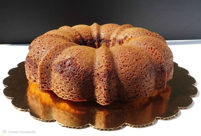 Cinnamon Sour Cream Coffee Cake | Unwed Housewife | Moist, fluffy coffee cake with a cinnamon sugar swirl. A simple, easy coffee cake recipe. This cinnamon sour cream coffee cake is so good, you'll want to eat it all day.
