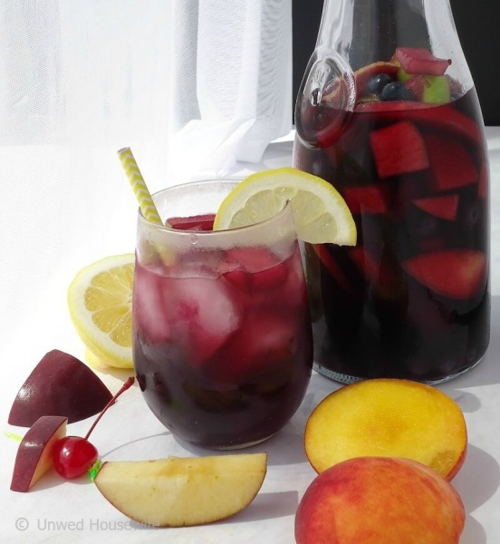 Sangria | Unwed Housewife | This sangria recipe is crazy good! Made with Spanish wine, rum, and fresh fruit, you're going to love this crazy good sangria.